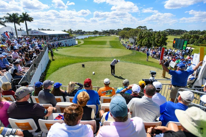 Spectators watch as Sungjae Im tees off from the 1st hole during the final round of the Honda Classic at PGA National Resort & Spa in Palm Beach Gardens last March. Tournament organizers will cap daily attendance for this year's event at 20 percent capacity amid the novel coronavirus pandemic.