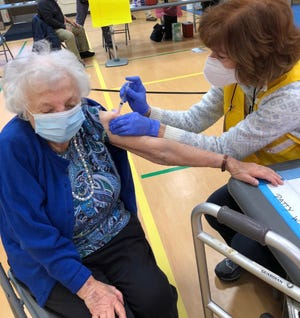Ethel Rubinstein, a 101-year-old resident of Warren, receives her first dose of the Moderna COVID-19 vaccine on Wednesday morning in Bristol.
