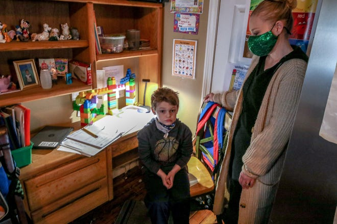 Pamela Ramsey, one of the parents outraged over the lack of in-person learning, with her son Christopher in their Pawtucket kitchen, where they are doing his school work.