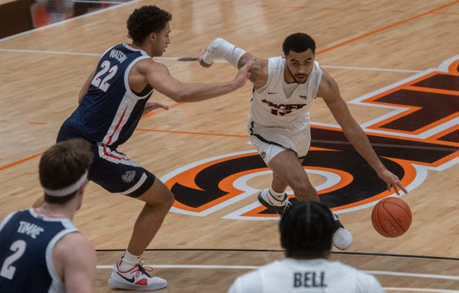 Pacific's Jeremiah Bailey, right, drives on Gonzaga's Anton Watson during a WCC men's basketball game Feb. 4 at Pacific's Spanos Center in Stockton.