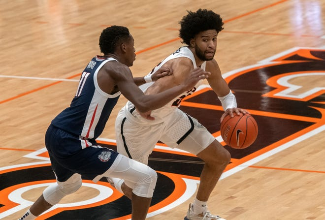 Pacific's Jahbril Price-Noel, right, drives on Gonzaga's Joel Ayayi during break in a WCC men's basketball game at Pacific's Spanos Center in Stockton.