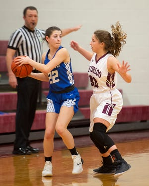 Waterloo hosted Jackson-Milton, with the Blue Jays taking the win 76-56. Hailey Waldeck on defense, Emily Fultz looks to pass.