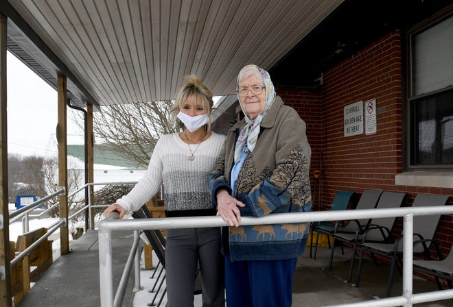 Golden Age Retreat Superintendent Dawn Faulk stands outside the Carrollton facility Friday with resident Kay Wagner. Carroll County is investing nearly $1 million on an air-treatment system.