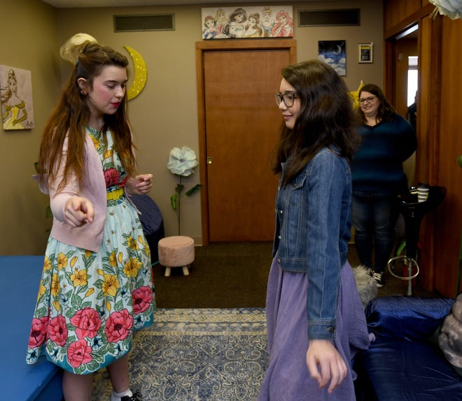 Molly Marie Crock, of The Luminescent Moon Theatre Co., works with acting student Brooke Wolfarth, 14, at the theater group's new location, 54 Federal Ave. NE, Suite B, in Massillon.