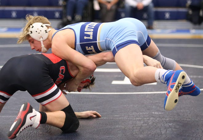 Garett Lautzenheiser (right) of Louisville defeated Logan Miller of Canfield in a 126 pound bout during their match at Louisville on Thursday, Feb. 4, 2021.