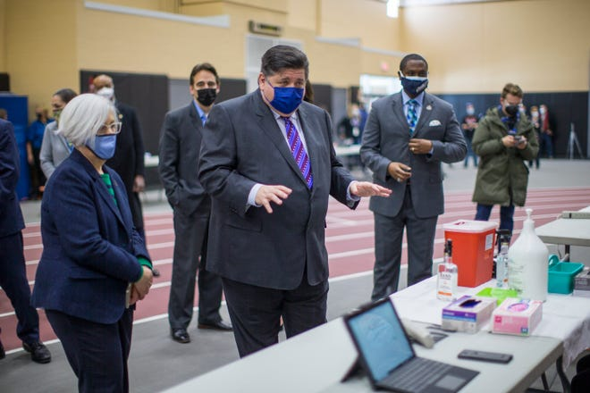 Gov. JB Pritzker, shown touring the Auburn High School Field House vaccination site in Rockford on Friday, said Wednesday that Illinois will expand its vaccine eligibility to those with underlying conditions by Feb. 25.