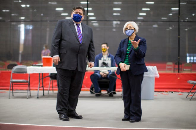 Gov. JB Pritzker, left, and Winnebago County Health Administer Sandra Martell tour the vaccination center at Auburn High School on Friday, Feb. 5, 2021, in Rockford, to showcase county and state-wide COVID-19 vaccination initiatives.