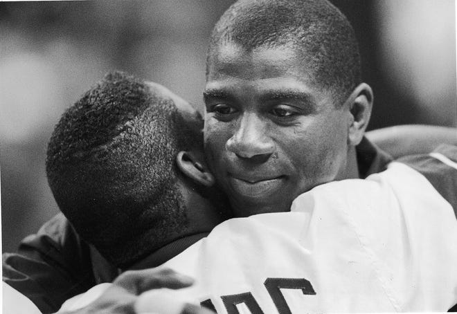West Guard Magic Johnson, right, hugs East Guard Isiah Thomas before start of the 42nd NBA All Star game at the Orlando Arena on Feb. 9, 1992, in Orlando. It was the first game of the season for Johnson, who retired from the NBA after testing positive for the AIDS virus.