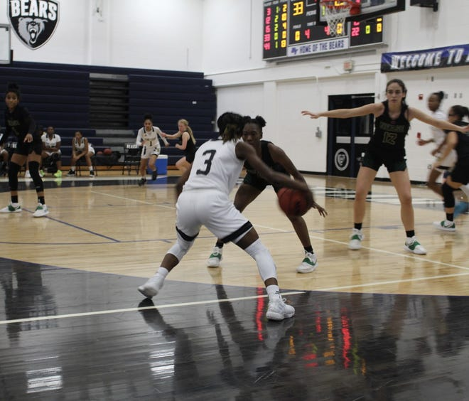 Oakleaf guard Kaylah Turner (3) dribbles as Nease guard Stephanie Manherz defends during the District 1-7A girls basketball final.