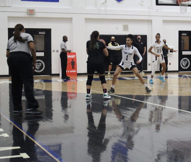 Nease Guard Sydney Gomes is being guarded by Oakleaf's Taliah Scott in the District 1-7A championship round Thursday night. Oakleaf won but Nease will still advance into the regional playoffs.