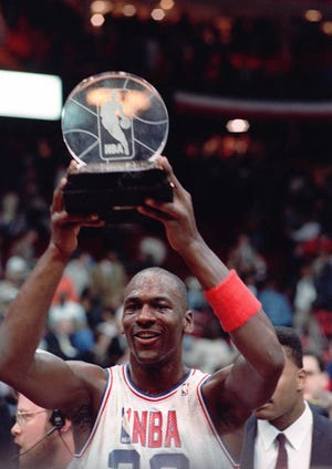 Michael Jordan holds the trophy for Most Valuable Player after the NBA All-Star Game on Feb. 7, 1988, in Chicago.  He was the unanimous choice for the title.