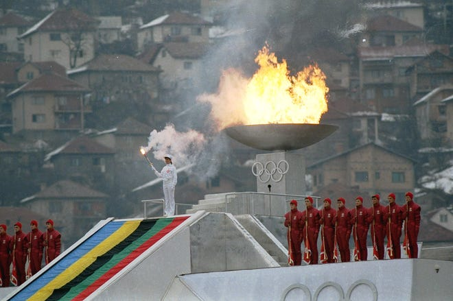 The Olympic flame is lit during the opening ceremonies for the XIV Winter Olympics in Sarajevo's Kosevo Stadium Feb. 8, 1984.