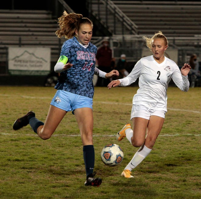 North Port's Emily Idoyaga plays the ball in front of Braden River's Emma Parrish during Thursday's district semifinal at the Preserve. The Bobcats will play Monday against Venice High at Powell-Davis Stadium for the district title.