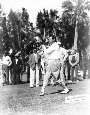 Babe Ruth, the King of Swat, teeing off at Bobby Jones Golf Course.