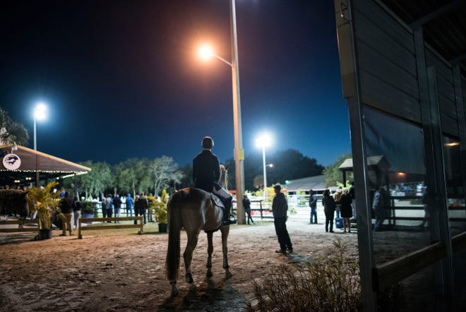 Fox Lea Farm, located on Auburn Road near Venice, hosts a variety of competitions including Show Jumping Under the Stars, pictured here. Owners of the popular venue fear that development of Murphy Oaks would impact the safety of horses as well as its viability.