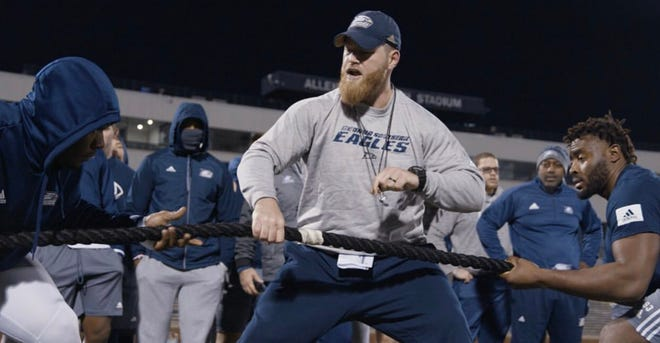 Georgia Southern University strength & conditioning director Matt Greenhalgh with the football team.