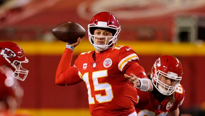 Kansas City Chiefs quarterback Patrick Mahomes throws during the first half of the AFC championship NFL football game against the Buffalo Bills Sunday, Jan. 24, 2021, in Kansas City, Mo. (AP Photo/Charlie Riedel)