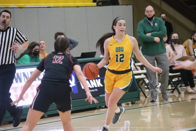 OBU's Charissa Price (12) dribbles the basketball against Southern Nazarene earlier this season.