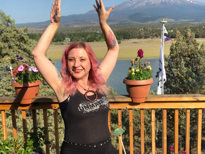 Belly dancing teacher Robyn Vandiver dances on the deck of her Shastina home in July, 2020.