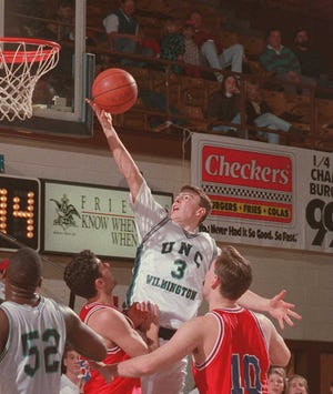 Mark Byington goes to the basketball for UNC-Wilmington against American.