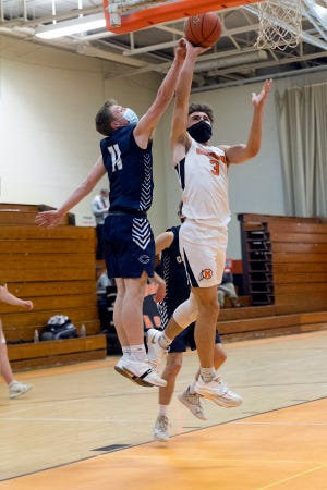 Middleboro's Wes James drives to basket for two Thursday night in South Shore League basketball action vs. Cohasset at the Joe Masi Gym. Middleboro took the win, 60-52, to win their fifth straight and improve to 5-1.