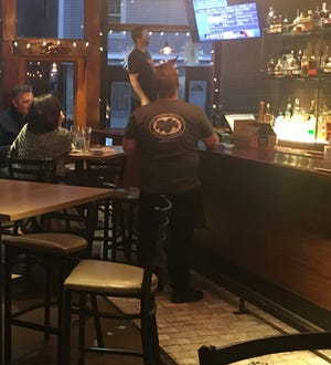 There are still few patrons at These Guys Brewing in Norwich on Wednesday  While restaurants are now allowed to stay open an hour later, owners still want to be allowed to seat more customers.