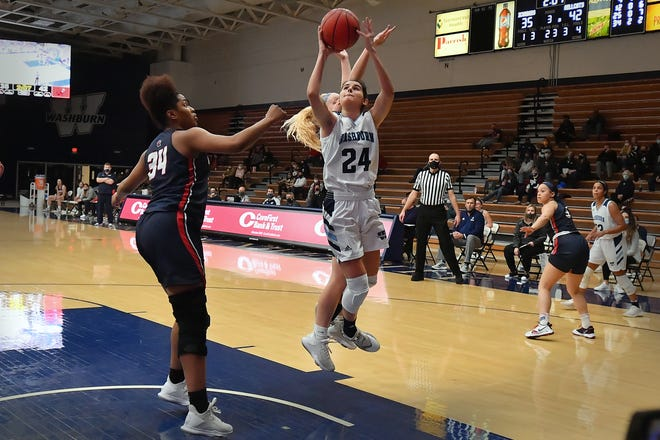 Washburn's Nuria Barrientos goes in for a layup against Rogers State on Thursday night at Lee Arena. Barrientos scored 10 points and had 10 rebounds, but the Ichabods fell 53-50.