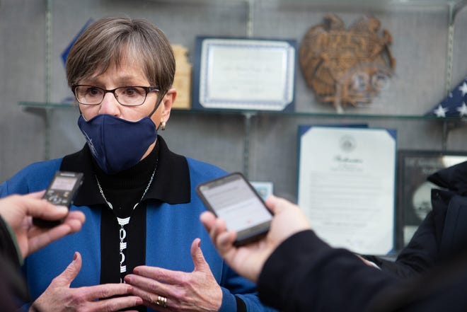 Gov. Laura Kelly takes questions regarding fraudulent unemployment claims filed with the Kansas Department of Labor while visiting the Kansas Air National Guard vaccination site Friday morning. Kelly said she was also a victim of the fraudulent claims.