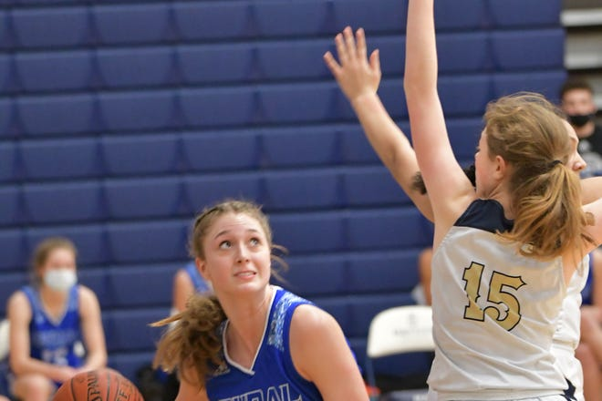 Washburn Rural's Brooklyn DeLeye looks for the basket against the defense of Hayden's Reagan Huscher during Thursday night's game at Hayden. DeLeye scored 16 of her 19 points in the second half to lead Rural to a 56-45 win.