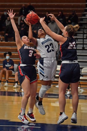 Waahburn's Hunter Bentley (23) goes up for a contested shot Thursday night against Rogers State's Katrina Christian (3) and Vanessa Gajdosova (23). Bentley put Washburn ahead late with a 3-pointer, but the Ichabods couldn't hold on, falling 53-50.