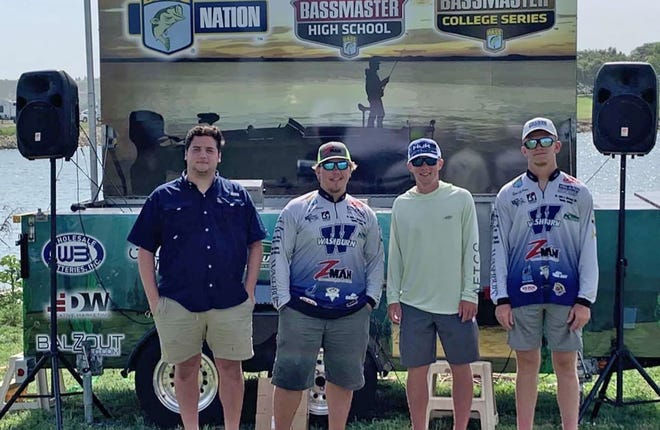 The Washburn fishing team huddles together following the Kansas BASS Nation College State Championship last June on Wilson Lake. The team will look to raise money to cover travel costs and entrance fees with an upcoming fundraiser tournament in March on Melvern.