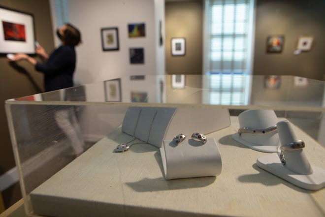 """Pieces of jewelry made by Donaldson's Jewelry are the first thing visitors will see as they enter the new exhibit """"Art from the Heart"""" at the NOTO Art Center. The exhibit features work created by local artists, ranging from glassware to paintings and photographs."""