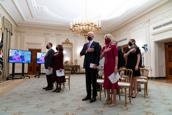 In this Jan. 21 file photo, Doug Emhoff, left, Vice President Kamala Harris, President Joe Biden, and first lady Jill Biden stand during a performance of the national anthem during a virtual Presidential Inaugural Prayer Service in the State Dinning Room of the White House in Washington. Biden addressed the National Prayer Breakfast, a Washington tradition that calls on political combatants to set aside their differences for one morning.