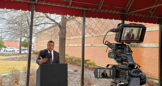 Fayetteville Mayor Mitch Colvin speaks about meeting with Dion Lyons with the U.S. Dept. of Justice during a news conference Friday outside the Police Department. City officials may request the DOJ's assistance in dealing with the Market House and other thorny issues involving race relations.