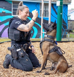Gainesville Police Department Officer Casey Walsh and Stern, a gun-sniffing dog.