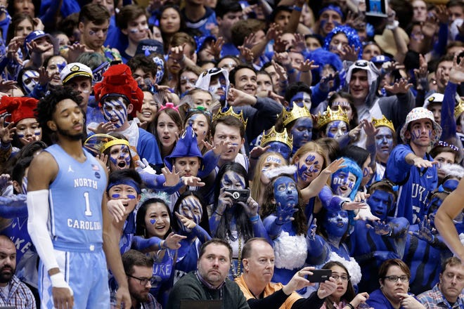 North Carolina's Leaky Black, left, shown here against Duke in March of last season, won't be greeted by such a scene this time around at Cameron Indoor Stadium.