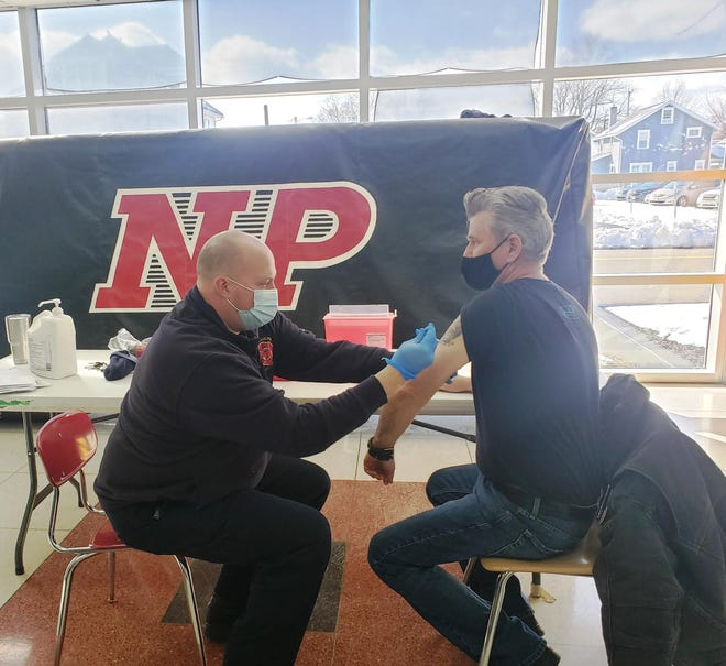 Gene Williams gets vaccine from NPFD Matt Tharp.