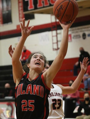 Hiland's Brynn Mullet drives to the basket as Tusky Valley's Ali Shane defends Thursday.