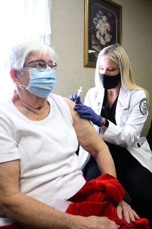 ARCOM fourth-year medical student Ashlyn Abbott of Walnut Ridge gives Letha Wells of Mulberry her first dose of the COVID-19 vaccine, Feb. 5 during the Coleman Pharmacy and First Baptist Church of Alma vaccine clinic set up at the church. A COVID-19 vaccine clinic will be held 8-10 a.m. Tuesday, March 9 at the Fort Smith Senior Activity Center and 9 a.m. to noon Saturday, March 13 at First United Methodist Church of Fort Smith, 200 N. 15th St.