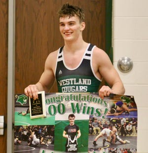 Westland junior wrestler Jakob Hurley earned his 100th career win Feb. 4 with an 8-2 victory over Dresden Tri-Valley's Jason Patterson.