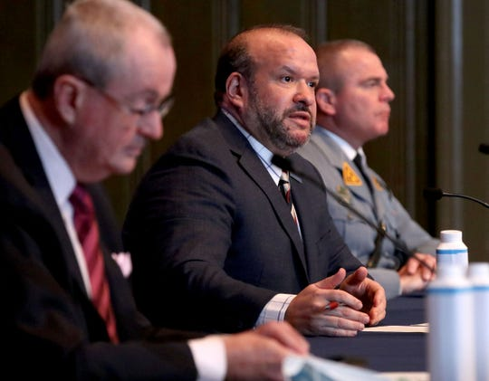 New Jersey Department of Labor and Workforce Development Commissioner Robert Asaro-Angelo (center) speaks during Governor Phil Murphy's COVID-19 update at the War Memorial in Trenton Friday, February 5, 2021.  At right is State Police Superintendent Colonel Patrick Callahan