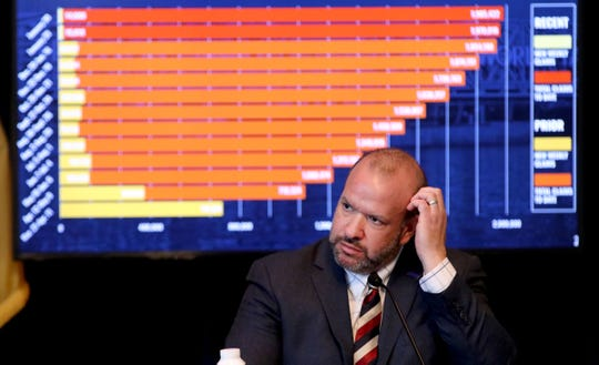 New Jersey Department of Labor and Workforce Development Commissioner Robert Asaro-Angelo is shown in front of a chart tracking initial unemployment claims during Governor Phil Murphy's COVID-19 update at the War Memorial in Trenton Friday, February 5, 2021.