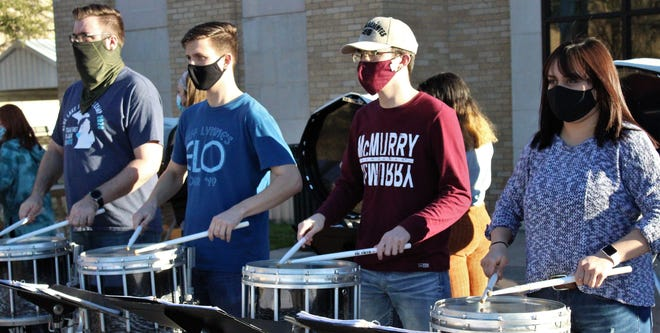 Drumming up support of the War Hawks football team are McMurry band members, from left, Dillon Lewis, Cypress, senior; Adam Clifton, Colorado City, sophomore; Kaleb Moss, Abilene, freshman; and Neyma Garcia, Canadian, senior. They were rehearsing for Saturday's home opener outside Thursday. Feb. 4 2021
