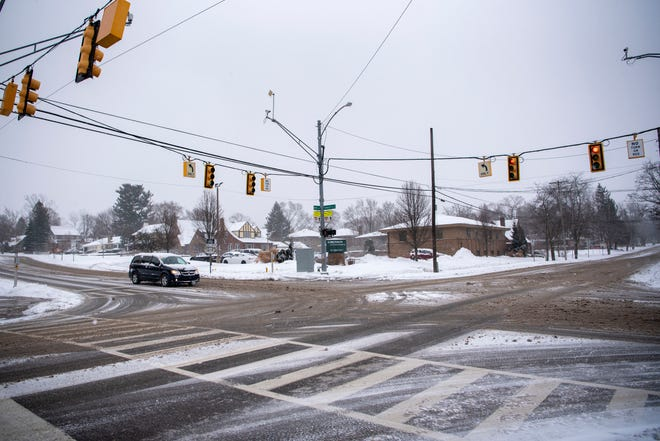Snow is cleared from Emmett Street and North Avenue on Friday, Feb. 5, 2021 in Battle Creek, Mich. Battle Creek is considering a roundabout near Bronson Hospital to slow traffic and protect pedestrians.