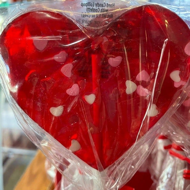Show your care with this heart-filled, heart-shaped lolli from The Station.