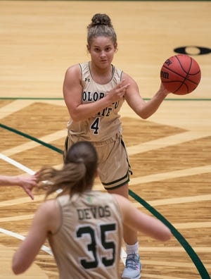 Colorado State Rams guard McKenna Hofschild (4) passes to Colorado State Rams guard Lore Devos (35) in the first quarter of the game at Moby Arena at Colorado State University in Fort Collins, Colo. on Thursday, Feb. 4, 2021.