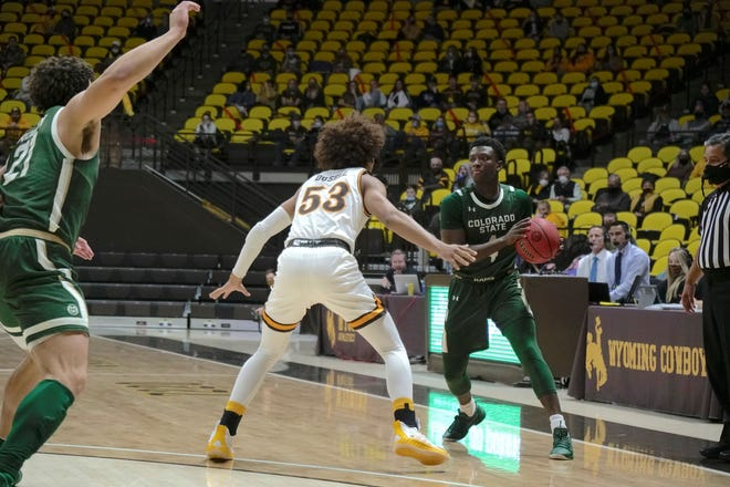 Colorado State basketball player Isaiah Stevens looks for a pass during a game against Wyoming on Thursday, Feb. 4, 2021.