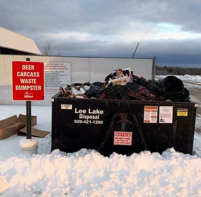 One of the deer carcass disposal dumpsters in Oconto County seen filled above the brim.