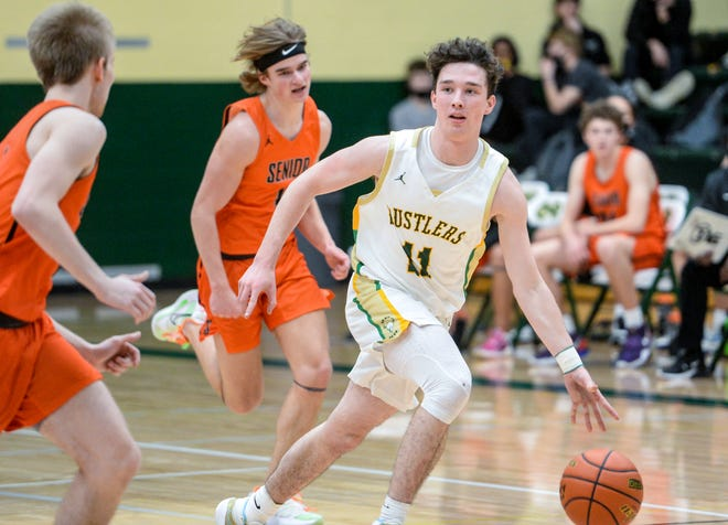 CMR's Raef Newbrough pushes the ball up court in Thursday's basketball game against Billings Senior.