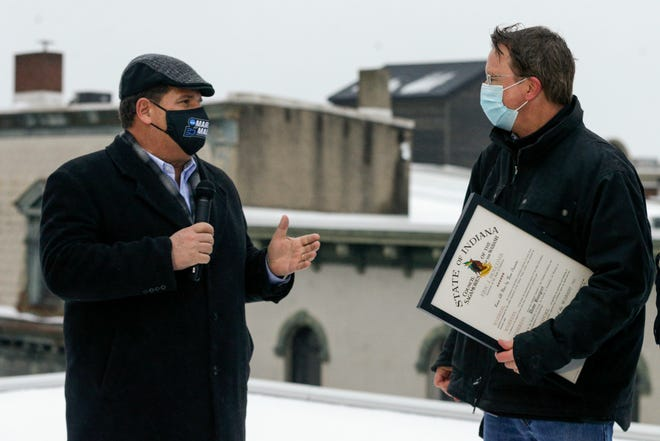 Lafayette Mayor Tony Roswarski, left, speaks after Dave Bangert, right, was presented with the Sagamore of the Wabash award, Thursday, Feb. 4, 2021 in Lafayette. The Sagamore of the Wabash award is Indiana's highest honor.